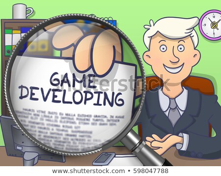 application development through magnifying glass doodle style stock photo © tashatuvango