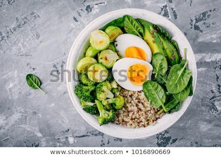 Brócolis ovo tigela vegetariano café da manhã escuro Foto stock © YuliyaGontar