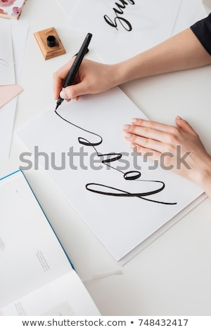 Close up of woman writing postcard Stock photo © IS2