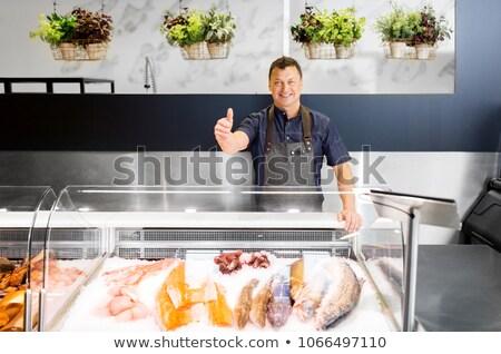 Fruits de mer vendeur poissons magasin Photo stock © dolgachov