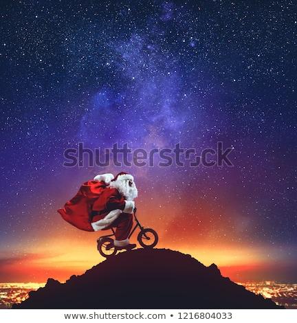 Mikulás kicsi bicikli csúcs hegy csillagok Stock fotó © alphaspirit