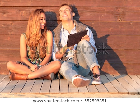 happy young women friends party outdoors in park having fun looking camera stock photo © deandrobot