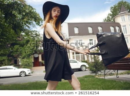 Kadın siyah elbise ayakta bağbozumu ayna Stok fotoğraf © dariazu