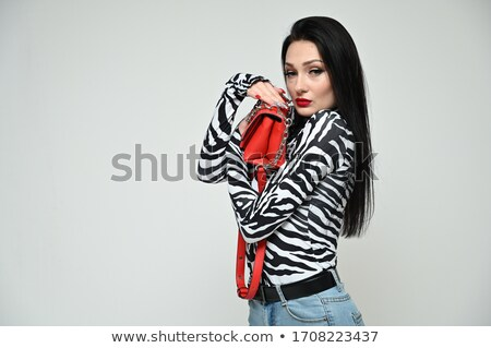 Positivity fashionable brunette in striped dress posing at street. stock photo © studiolucky