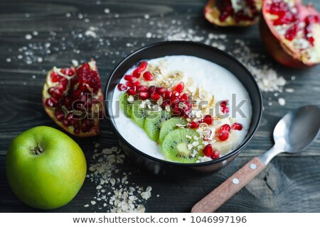 Smoothie with oat or oatmeal, banana and pomegranate Stock photo © Illia