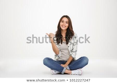 Portré boldog fiatal nő ül lábak keresztbe laptopot használ Stock fotó © deandrobot