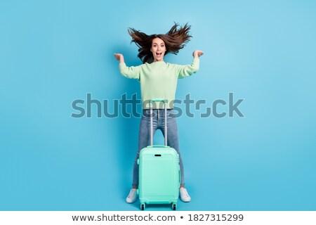 Fotografia radosny uśmiechnięta kobieta stałego lotniska bagaż Zdjęcia stock © deandrobot