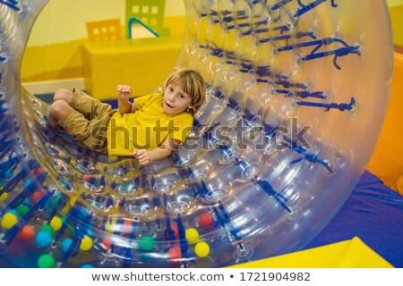 cute · weinig · jongen · spelen · plastic · cilinder - stockfoto © galitskaya