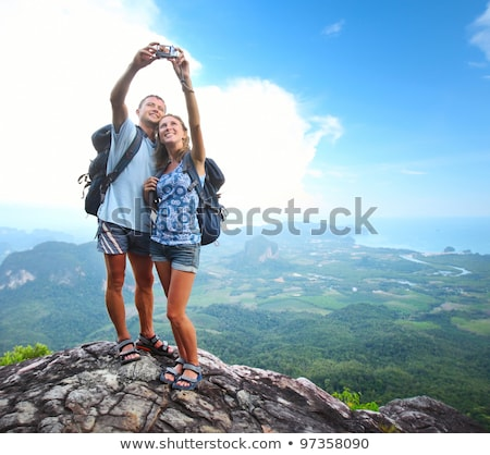 Tourists Cuople with Photo Camera, Mountain View Stock photo © robuart