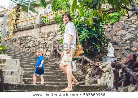 Apa fia gyönyörű kő katolikus katedrális Vietnam Stock fotó © galitskaya