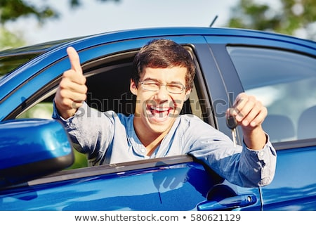 Happy student of driving school showing car keys Stock photo © Kzenon
