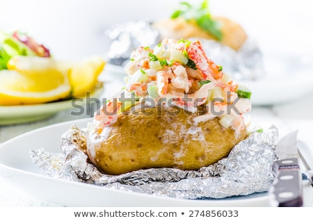 baked potato with sour cream and fresh dill stock photo © joannawnuk