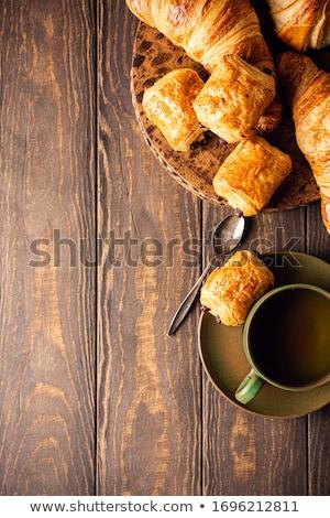 Green cup of tea with mini chocolate bun Stock photo © Melnyk