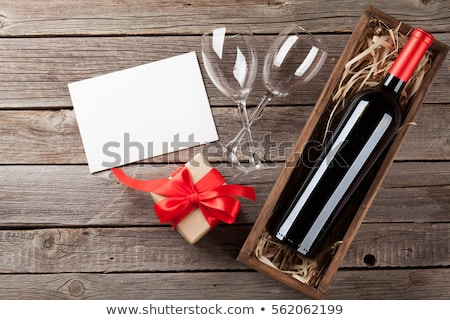 Champagne bottle and gift box Stock photo © karandaev