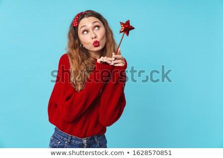Image of amusing blonde woman holding magic wand and making kiss lips Stock photo © deandrobot