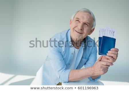 Sonriendo feliz hombre pasaporte entradas Foto stock © deandrobot
