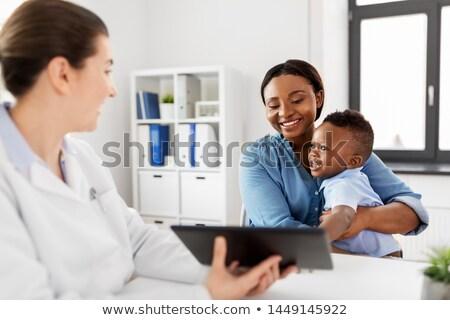Médecin bébé patient clinique Photo stock © dolgachov