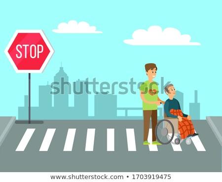 Volunteer Help Granny in Wheelchair to Cross Road Stock photo © robuart