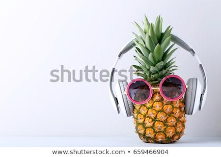 Rijp ananas zonnebril hoofdtelefoon smartphone Blauw Stockfoto © karandaev