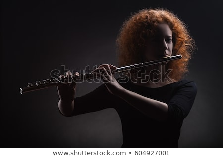 Young woman playing transverse flute Stock photo © fahrner