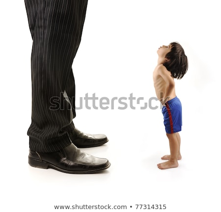Little small child  is looking at the giant legs of  businessman adult Stock photo © zurijeta