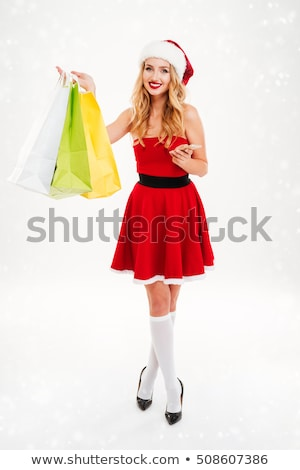 beautiful blond woman in christmas costume with shopping bags Stock photo © Nobilior