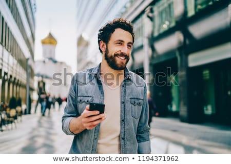 Lezser férfi küldés sms mobiltelefon fehér Stock fotó © broker