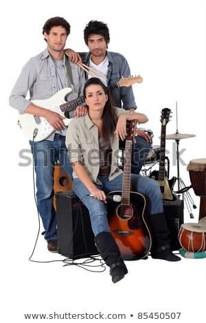 Rock band posa donna musica chitarra corpo Foto d'archivio © photography33