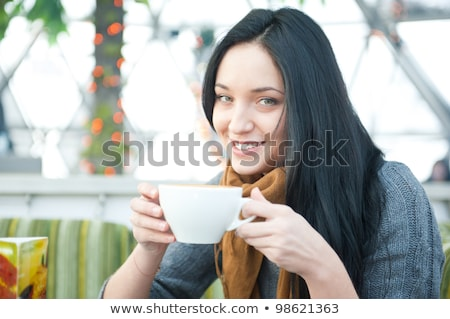 Closeup portrait of a pretty young female having a cup of coffee Stock photo © HASLOO