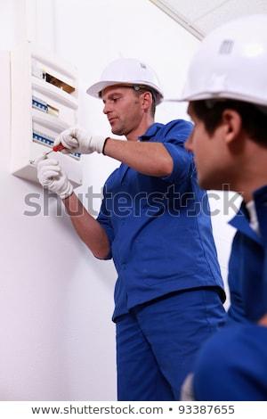 Tradesman repairing a distribution board Stock photo © photography33