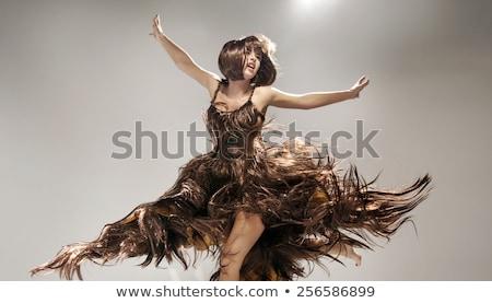 Blond beauty wearing dress made by hair Stock photo © konradbak