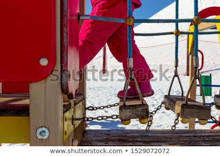 Girl holding onto a rope in a playground Stock photo © photography33