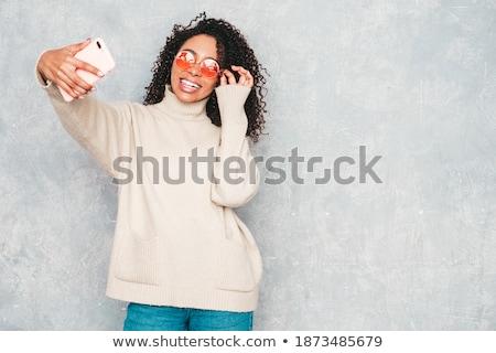 sexy woman posing in black stock photo © adamr