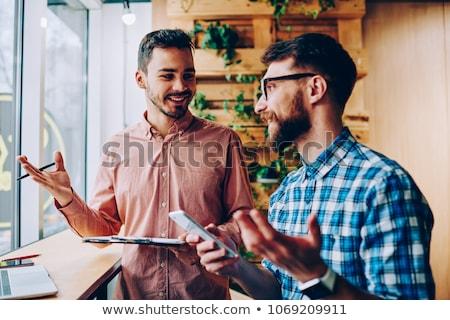 Jeune homme téléphone blanche affaires sourire technologie Photo stock © Rebirth3d