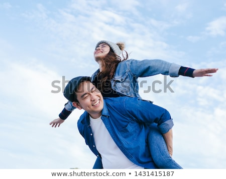 Woman riding piggy-back on a man Stock photo © photography33