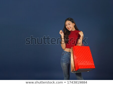happy beautiful woman wearing blue jeans holding her arm stock photo © Rob_Stark