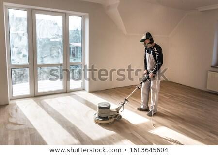 Man sanding plank of wood Stock photo © photography33