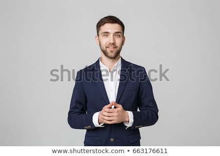 business man in grey suit on white background in studio stock