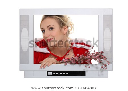 Woman dressed in festive outfit coming out of television Stock photo © photography33