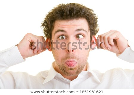 Man Sticking Out Tongue and Pulling Silly Face Stock photo © scheriton