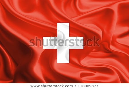 Political waving flag of Switzerland Stock photo © perysty