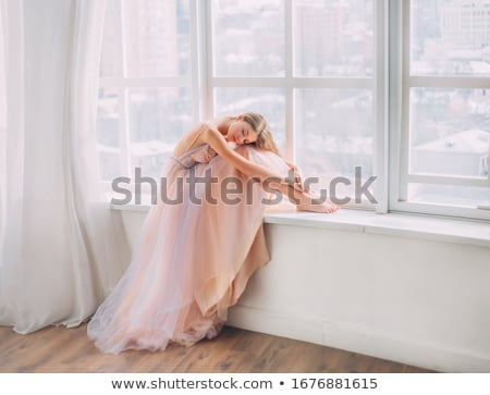 Beautiful blonde woman in a pink evening long dress. Stock photo © Pilgrimego