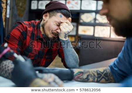 Pain of a tattoo Stock photo © sumners