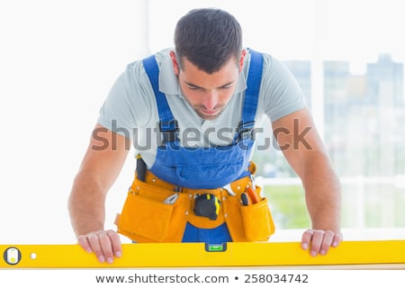 Workman using a spirit level Stock photo © photography33
