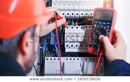 Electrician with a multimeter Stock photo © photography33