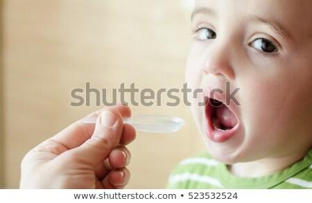 Little boy taking cough medicine  Stock photo © wavebreak_media