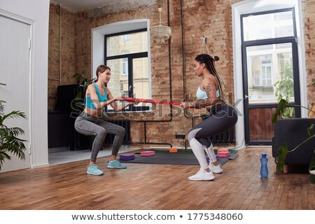 Concentrated fitness woman doing a workout. stock photo © Reaktori
