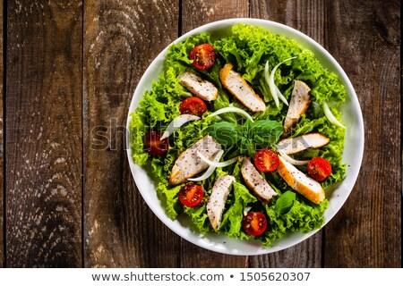 barbecue chicken and caesar salad stock photo © dbvirago