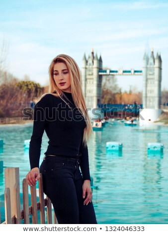 Woman surrounded by reeds near a lake Stock photo © photography33