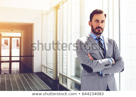 Serious businessman standing with his arms crossed Stock photo © wavebreak_media